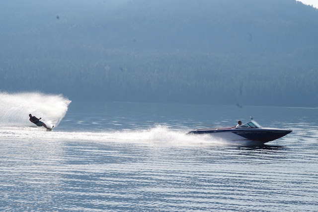 Craig Hill of Hill's Resort tows a waterskier on an early morning sheet of glass on Priest Lake.