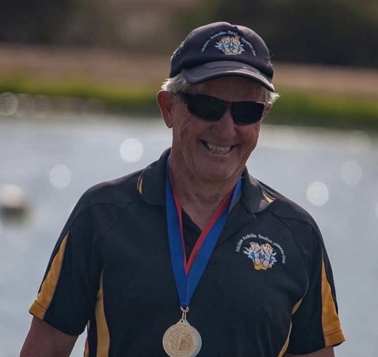 Barry Delaporte with a medal