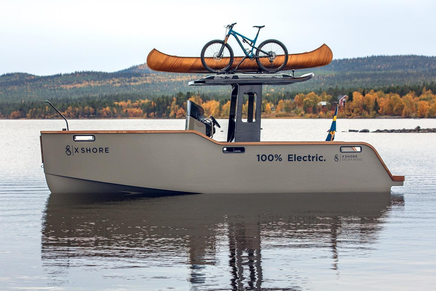 Eelex 8000 from X Shore stationary with bicycle on roof rack