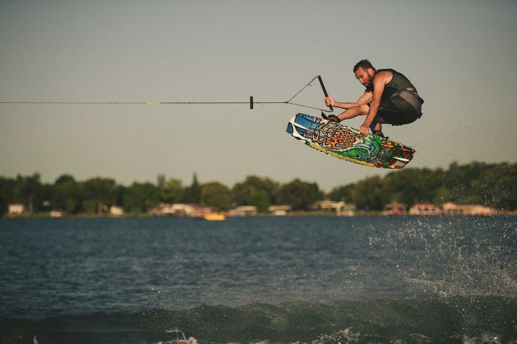 Wakeboarder using the special edition liquid force wakeboard
