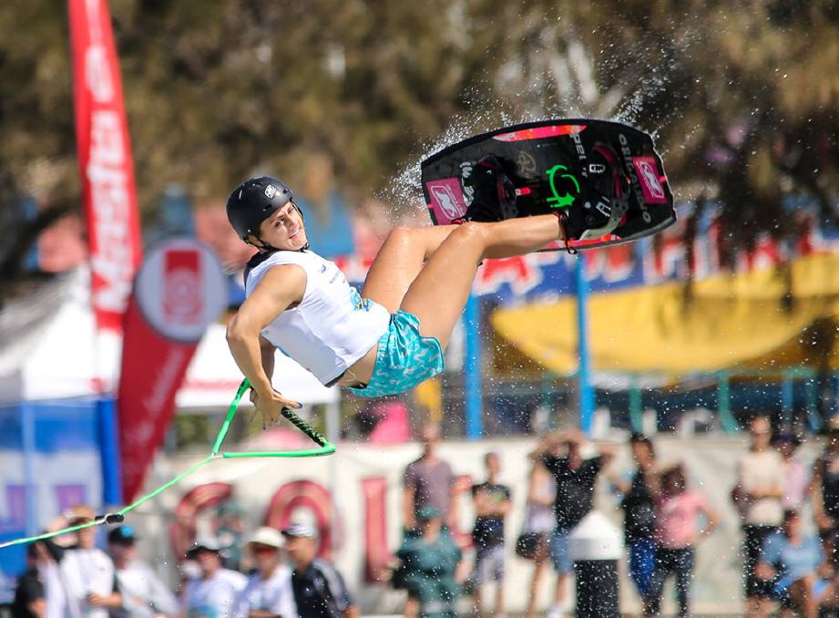 woma n wakeboarding at competition