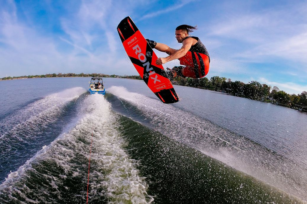 From water-level, Sam Brown doing a flip on his wakeboard.