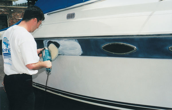 Someone applying gelcoat to a boat.
