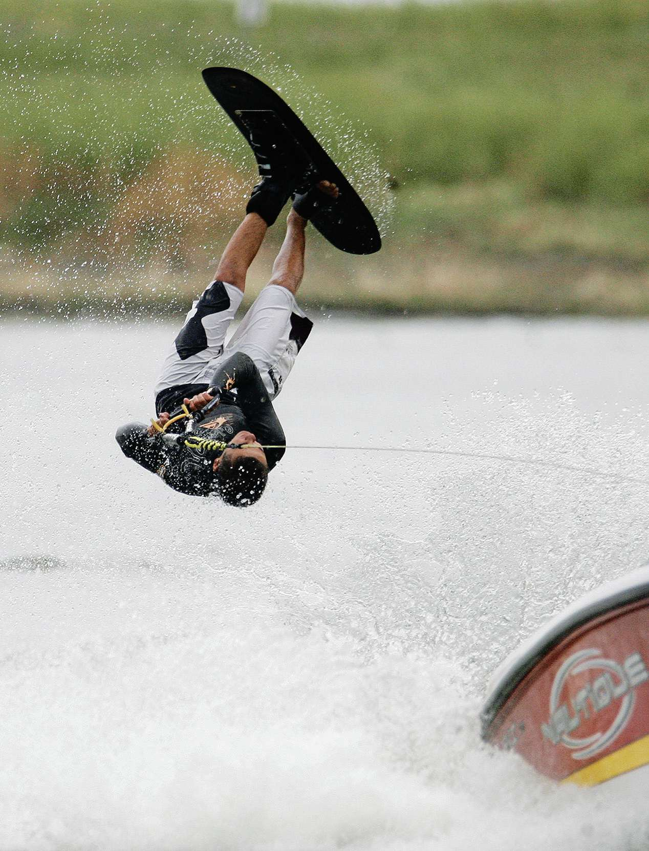 Cole grant wakeboarding - mid-air.