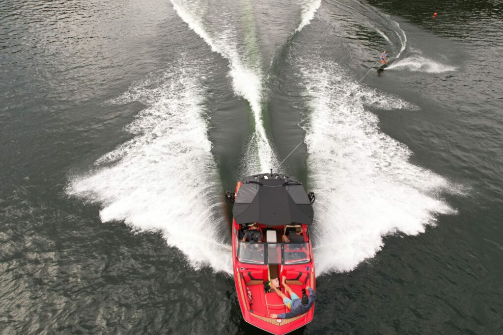 Aerial shot of a powerboat towing a wakeboarder.