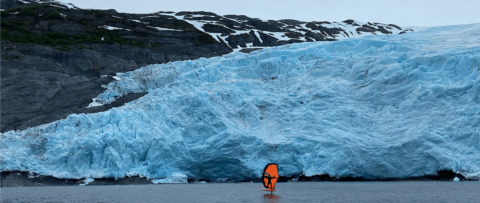 Wing foiling in front of a glacier like feature.
